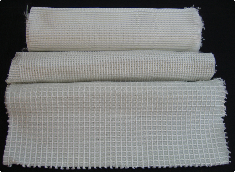 Reinforced stitched polyester non-woven fabrics